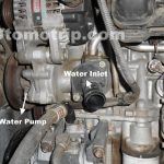 Gambar water pump pada mesin 1nz-fe toyota